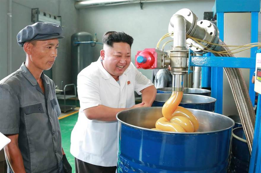 Kim Jong-un watching industrial lubricant being produced.
